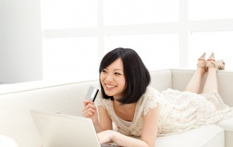 Beautiful young woman using a laptop computer. Portrait of asian